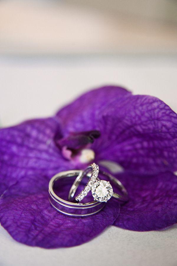 weddings rings detail on purple flower - Honolulu destination wedding photo by top Hawaiian wedding photographer Derek Wong