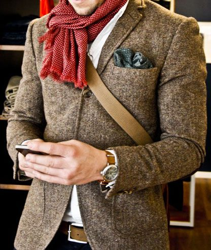 Appears to be a heather tweed jacket. I like the watch as well, but black is more my color for bands. This really does need the pocket silk to work though.