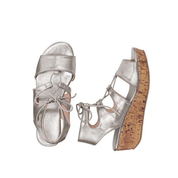 Lace-It-Up Ghillie Wedge. The lace-up style mixes delicate uptown flair with a bit of downtown edge. Perfect for the summer season!  FEATURES• Silver metallic upper with adjustable laces along the instep; silver lining footbed• Faux-cork wedge  MATERIALS• PU (Polyurethane) and TPR (Thermal Plastic Rubber)  Made in China.