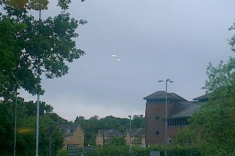 The photo was taken as the witness came out of the Running Horse Pub in the Berkshire town of Bracknell at 8pm June 14, 2013. A UFO expert, formerly from the Ministry of Defence says the photo is 'one of the best' he has seen.
