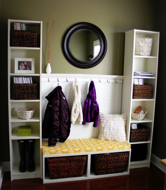~ DIY Mudroom Area ~  Created using:  * Bookshelves/Bench from IKEA  * Bead board from Lowe's  * Foam/fabric cushion (JoAnn's)  * 2 sets of hooks w/shelf  * Target mirror/ baskets:
