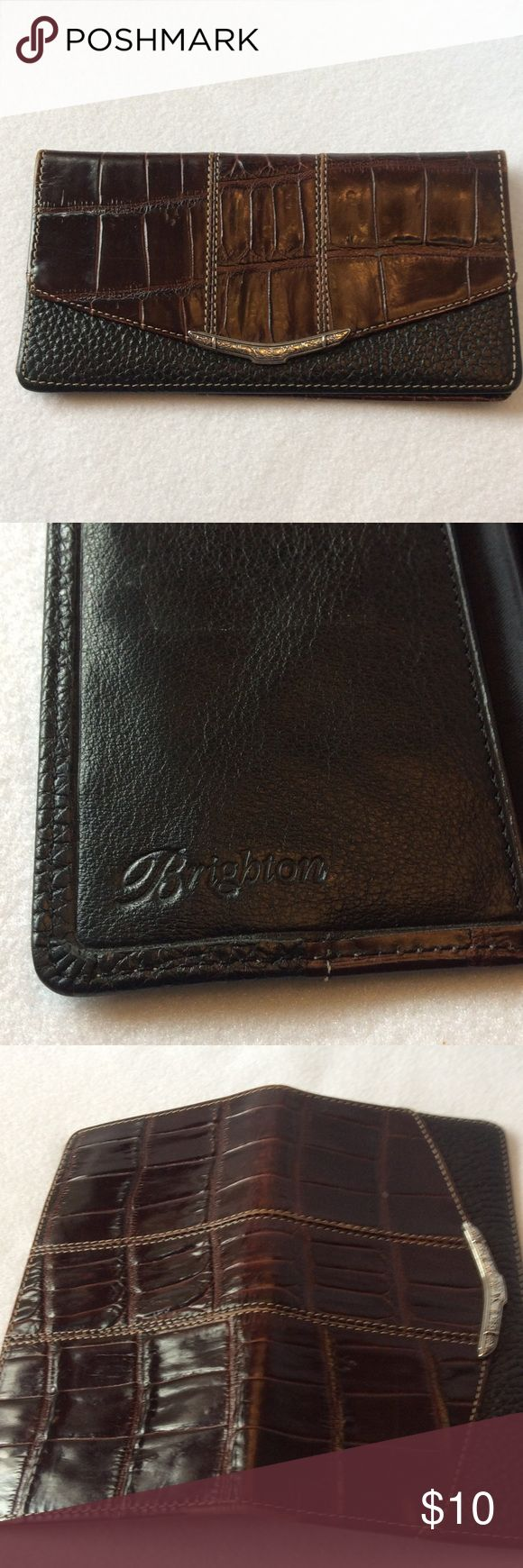 Brighton Checkbook & Credit Card Holder Attractive Brighton credit card and checkbook holder.  This has 4 slots and a pocket on one side and the checkbook holder with clear duplicate check divider on the other.  Rich croc and pebble grain pattern on the outside with a gorgeous stamped silver decoration!  Enjoy! Brighton Accessories Key & Card Holders