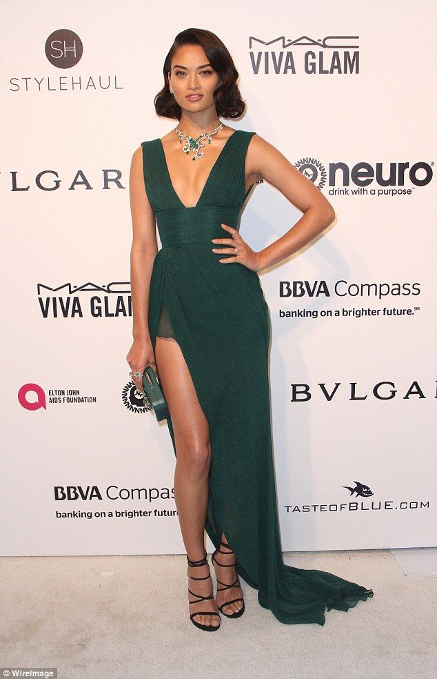 Green goddess: Shanina Shaik turned heads at the Elton John AIDS Foundation's Oscar Viewing Party in West Hollywood on Sunday night, channeling old school Hollywood glamour in a very revealing gown