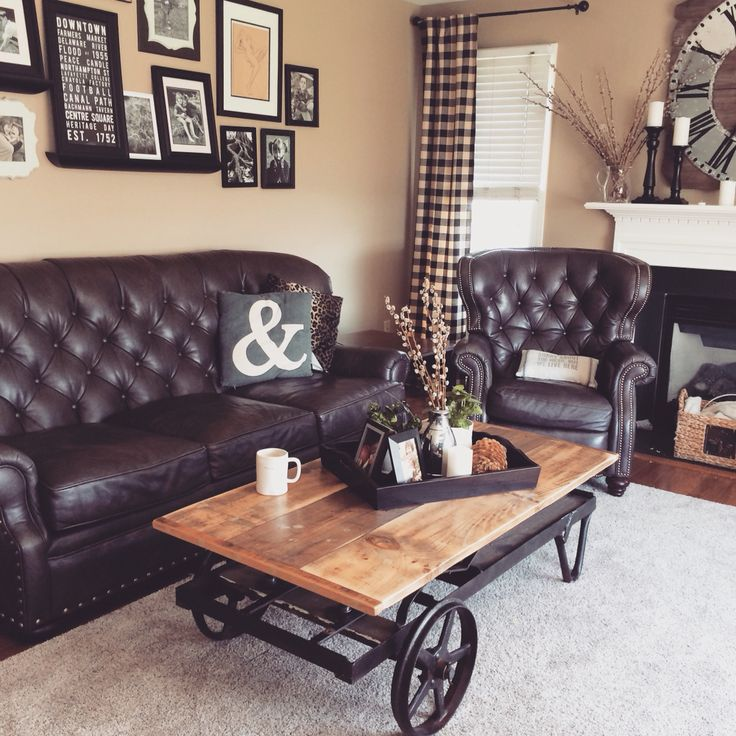 french farmhouse with a mix of industrial tufted leather couch and man chair with nailheads