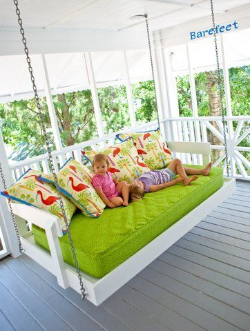 Hanging Daybed    Designer Jane Coslick is known for her cottage creations, and this hanging daybed is one to remember. A crib mattress becomes a cozy swing for kids of all ages and their parents.