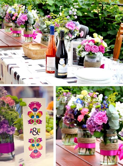 wesele w stylu rustykalnym - słoiki owinięte dratwą i wstążką, jako wazony na kwiaty