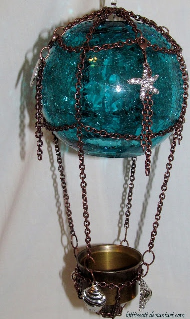 """Glass bubble hot air balloon. This isn't """"steampunk"""" per se, but steam and hot air devices are what the genre is all about and I love the chain links and nautical embellishments. This would be wonderful decor for steampunk themed living room."""