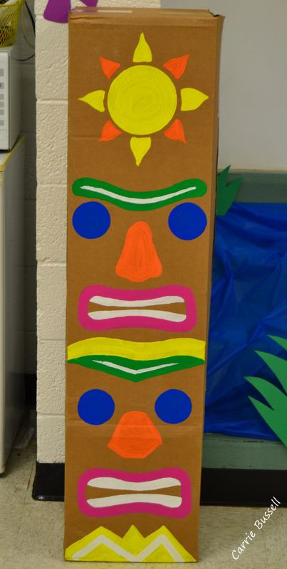 Totem pole painted on cardboard box. Cheap luau decorations.