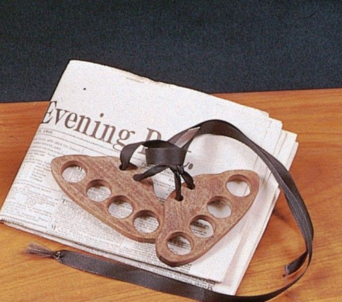 The finger stocks would have been used to hold children's fingers behind their backs to prevent fidgeting.These are a replica version, but serve well to give modern children a taste of Victorian punishment. Wooden with ribbon ties. Each half of the stock measures about 5cm x 11cm.