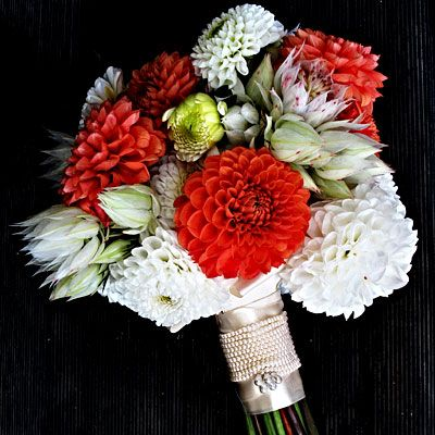 """Say """"I Do"""" to this textural dahlia and blushing bride protea bouquet."""