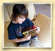 """Make a String-Thing, A simple """"first guitar"""" type instrument craft."""