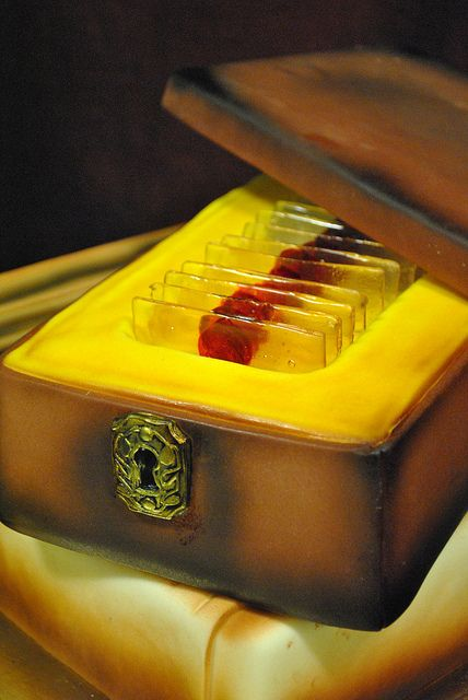 Dexter Cake by Bleeding Heart Bakery. His precious blood slides of all his victims.