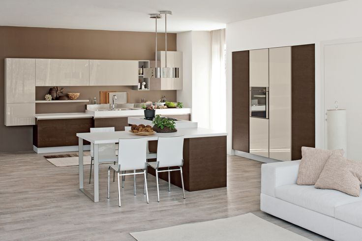 Compositional flexibility and a myriad of colours, materials and finishes to choose from. A #pure and #ergonomic #kitchen #design, featuring doors with built-in handles for maximum practicality. Coloured glass, okite, marble, laminate, steel and plenty other finishes are offered by #LUBE to customise your #kitchen worktop.