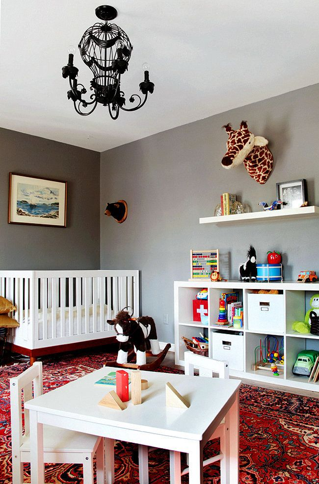 Nursery with sophisticated color palette and Persian rug