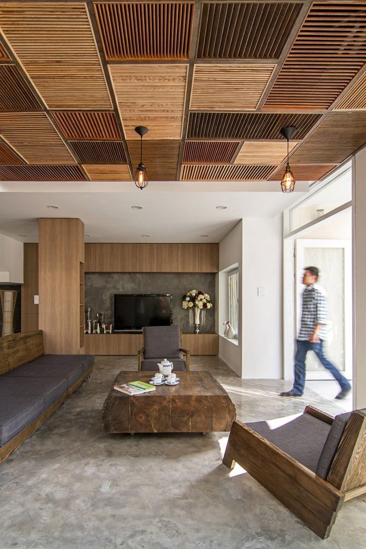 a patchwork of wood shutters cover the wall and ceiling in this home - Ceiling Design Ideas