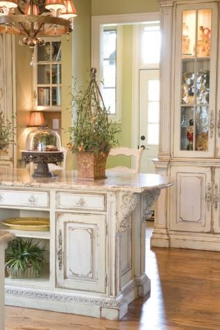 This Luxurious Kitchen Design Features High Ceilings, Wood Beams, And Country  French Kitchen Cabinets In A Hand Distressed Antique White Crackle Finish.
