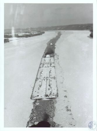 Barge carrying fuel oil and kerosene to Louisville is unable to reach its destination on the frozen Ohio River 1977