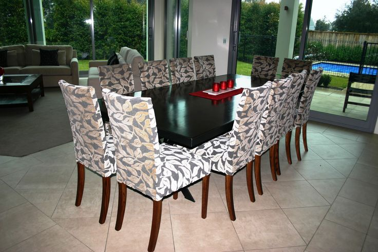 Dining Table and Chairs from Designers' Collection.