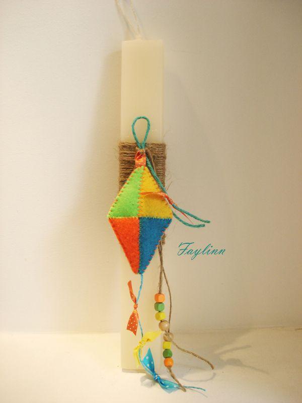 χειροποίητος τσόχινος χαρταετός δεμένος με σπάγκο σε πλακέ κερί