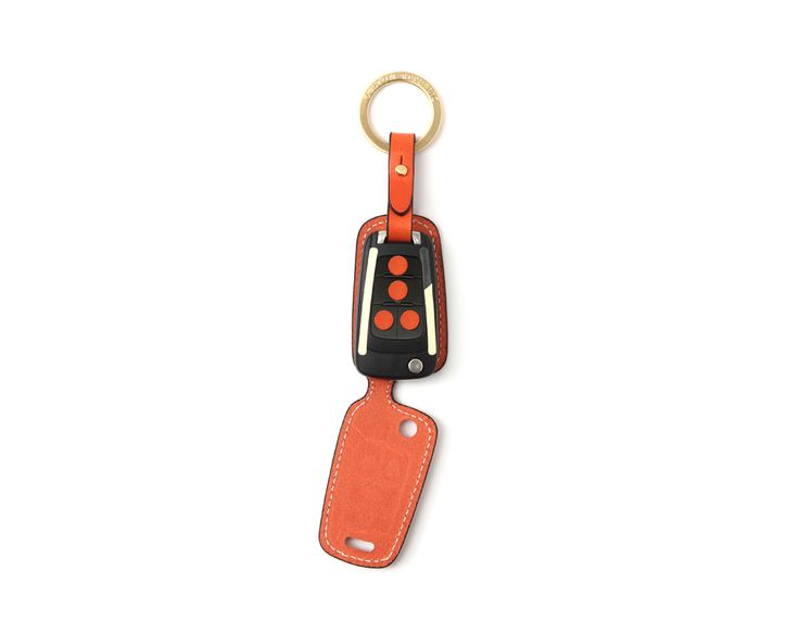 Chevrolet leather key case.  Handmade Buttero Leather Smart Key Cover/Case   -Handmade by: Custom Republic  -Leather: Vegetable leather from Conceria Walpier & Vera Pelle -Attachment pieces: 18K gold satin coating - Colors: natural, yellow, orange, brown, navy, and camouflage -Thread & Stitching: Serafil (from Germany)  -Measurement: 4 cm x 14.1 cm