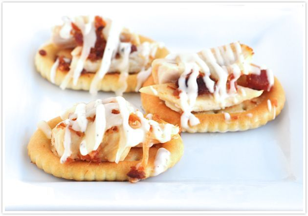 """Chicken, bacon and ranch sliders for Super Bowl finger foods / appetizers < neat idea... use oval crackers and they'll be shaped like footballs too! #superbowl ***Everyone liked them, but I dropped them from my yearly menu because they are a pain to make and have look """"neat"""" like in the photo."""