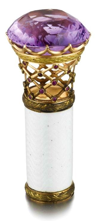 FROM THE ESTATE OF FRANCES H. JONES: A Fabergé Amethyst, Gold and Enamel Parasol Handle, Moscow, circa 1900, the large cushion-shaped faceted amethyst handle supported on an openwork mesh basket in gold, the intersections set with rubies, the collar within two-color gold laurel bands and enameled translucent oyster over a wavy guilloché ground.