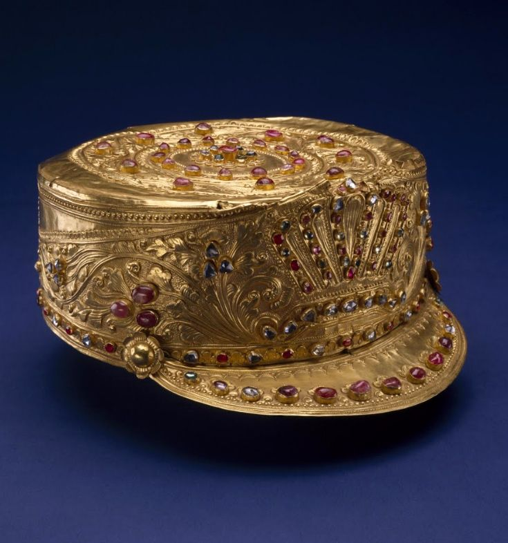 Indonesia | King's crown from the Balinese Royal Court of Singaraja. Inspired by a Dutch colonial army uniform | Gold, rubies, diamonds and sapphires | Late 19th century, Nias