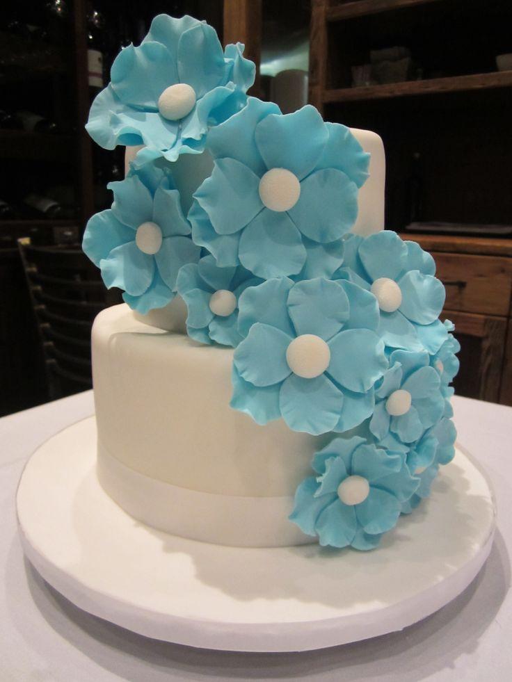 Blue flowers on white fondant. Flower cascade.
