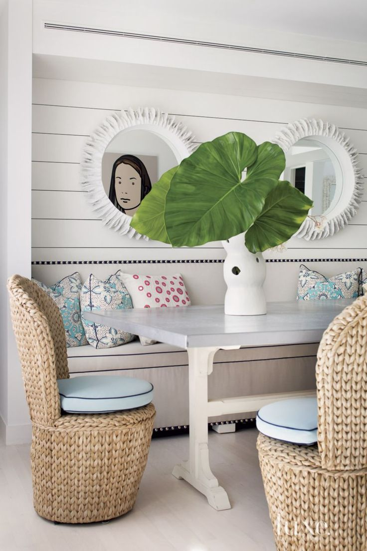 Eclectic White Dining Room With Banquette Seating Minus The Elephant Ears