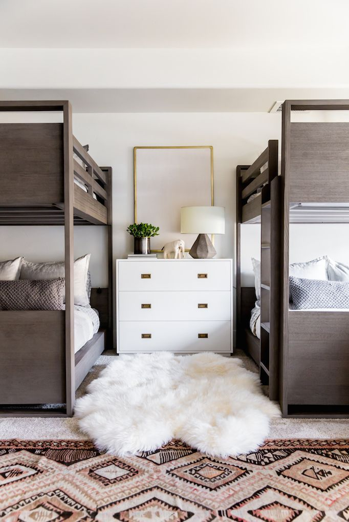 Modern Bunk Room. A kid-friendly, cozy space with layers of warm neutrals, rustic wood, Benjamin Moore Swiss Coffee paint and brass accents.