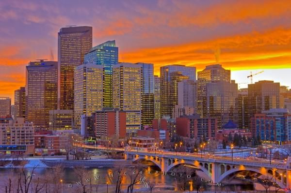 Picture of the Calgary city skyline during sunset after light snowfall.