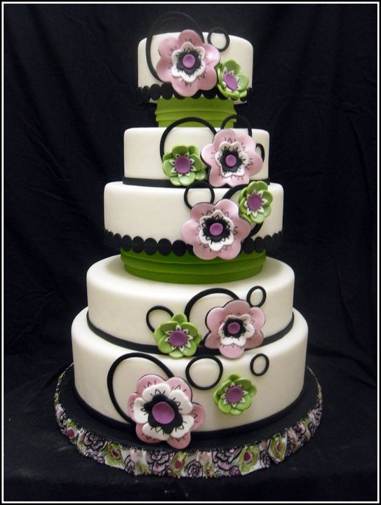 White, Black, Pink and Green Wedding Cake - This cake was made for our very first cake competition.  The inspiration came from the ribbon at the bottom of the cake.  The cake won first place in it's division.