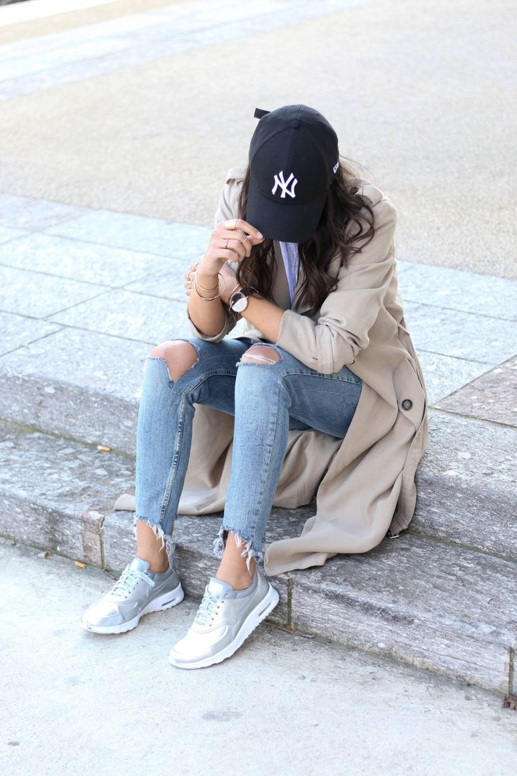 """justthedesign: """"Add some cool and casual vibes to your trench coat look by accessorising with a NY Yankees cap or a pair of metallic sneakers, like Federica L! This laid back style is perfect for..."""