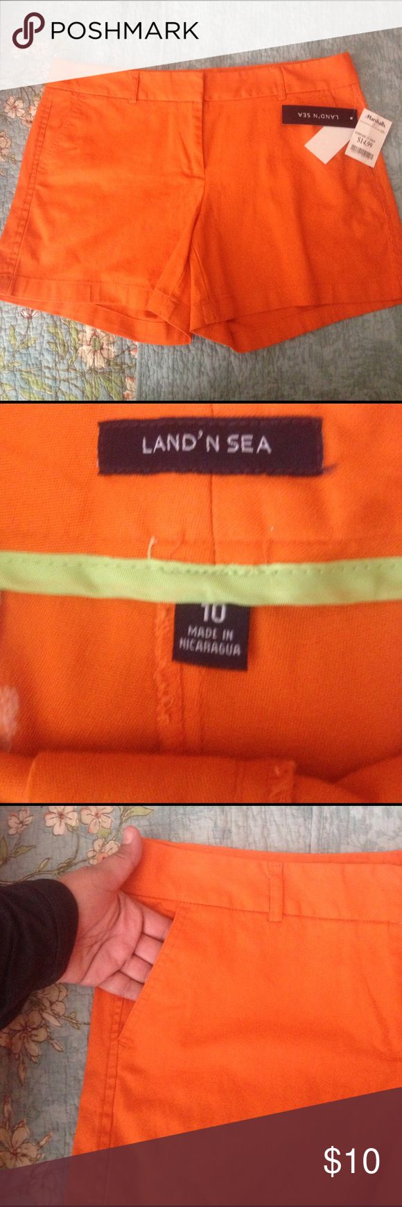"Women's Orange Shorts by Land 'n Sea New with tags!!!  Orange shorts, with front pockets, 13"" length, from waist to hem of shorts. Shorts"