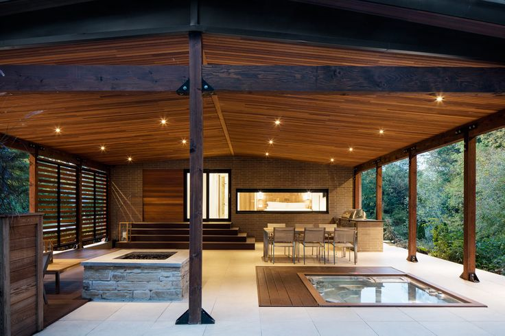 This minimalist #terrace has an #outdoor #kitchen, hot tub, and fire pit for a fun evening of entertaining.
