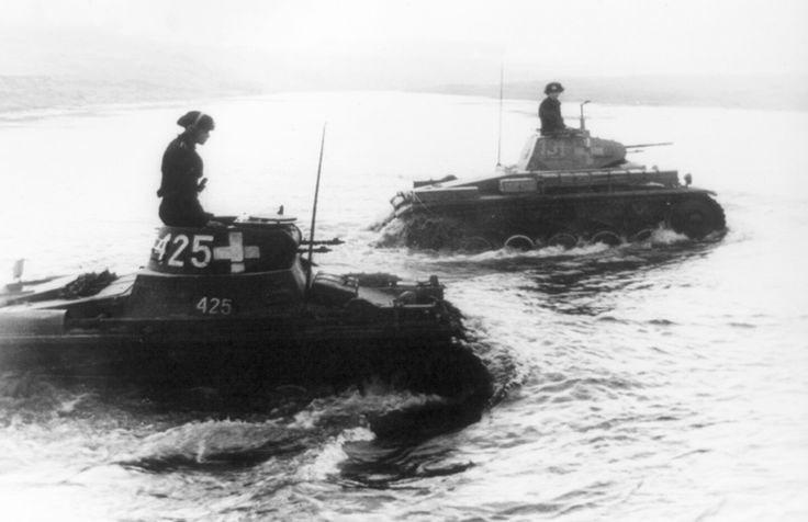 Two tanks of the SS-Leibstandarte Adolf Hitler Division cross the Bzura River during the German invasion of Poland in September of 1939. The...