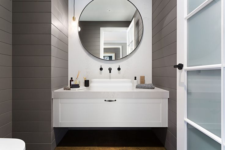 POWDER ROOM: Fresh and inviting, this coastal inspired powder room is crisp, clean and uncluttered. The use of large stone panels along with timber wall panelling is the perfect blend of a country life and high end charm. Visit Southampton on our Lookbook here: http://www.metricon.com.au/get-inspired/lookbook/southampton