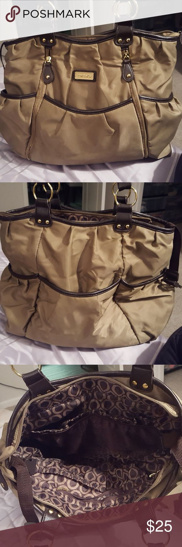 Carter's bag, perfect for travel! It's intended use is a diaper bag, but I've used it for travel because it's so stylish and perfect with all the pockets especially on long flights or over nights. Multifunctional! Carter's Bags
