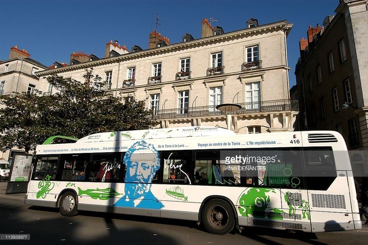 In the footsteps of Jules Verne in Nantes, on the occasion of the celebration of the centenary of his death in Nantes, France In January, 2005-Bus Nantes colors of Jules Verne.