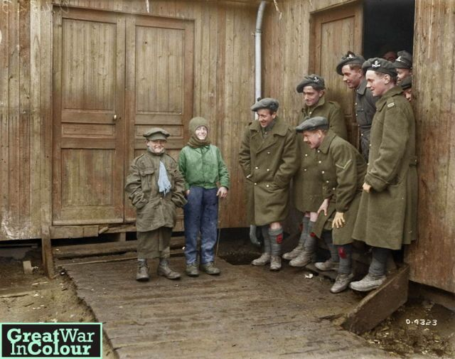 Two French boys goof around with members of the 4th Canadian Division. Taken in March, 1919 at an embarkation camp in Havre, France.