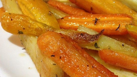 Fall and winter root vegetables are roasted in the oven with thyme sprigs and a drizzle of maple syrup to make a great side dish to go with any meal.