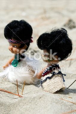 Maori Souvenir Dolls on Beach, New Zealand Royalty Free Stock Photo