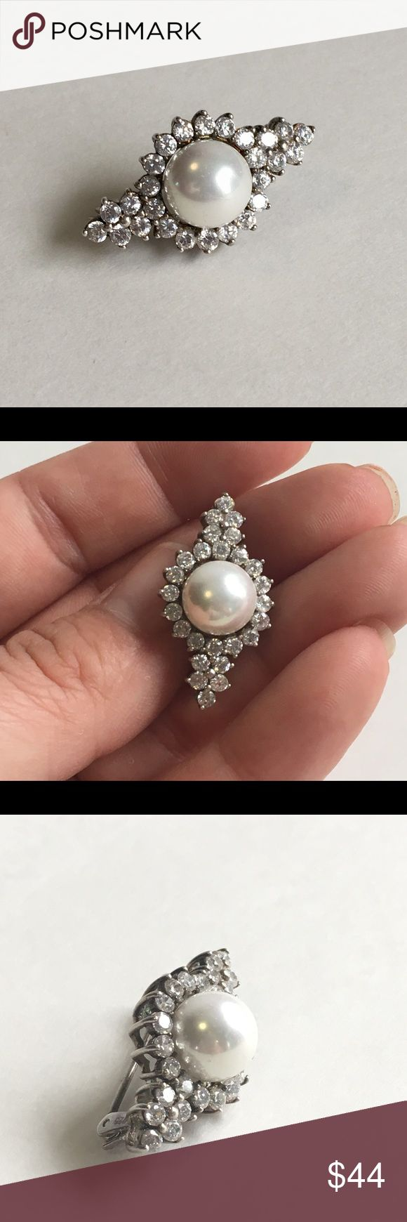 Pearl and CZ Sterling Silver Brooch 925 Vintage A gorgeous Sterling Silver Brooch with sparkly cubic zirconia and a lustrous faux Pearl. This is a petite piece but will definitely get noticed as the CZ's and Pearl really catch the light. This would make a great gift! Stamped 925. Good vintage condition with some tarnish and patina. Check out the photos and use them as part of the description. My closet is packed with amazing vintage jewelry, check it out. 💕😍❤️ Vintage Jewelry Brooches