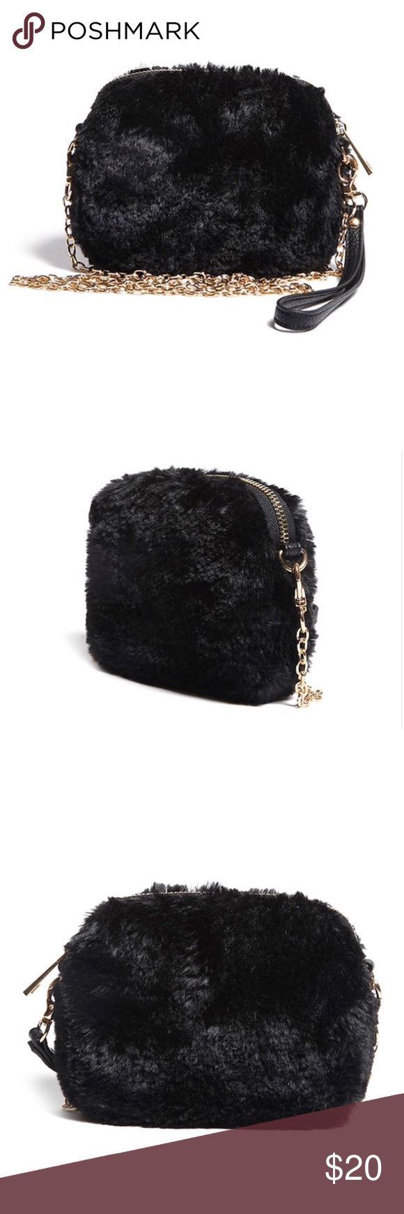 "NWT Faux Fur Mini Crossbody NWT Faux Fur Mini Crossbody   A faux fur mini crossbody featuring a zip-top closure, a detachable chainlink shoulder strap, a detachable lobster clasp wristlet strap, and an interior zip pocket.  Measurements: - Height: 5"" - Width: 6.25"" - Depth: 2"" Bags"