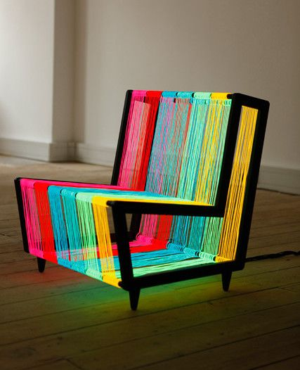 Kiwi & Pom | The Disco Chair is a modern lounge chair that is strung with electroluminescent wire that is illuminated when powered.