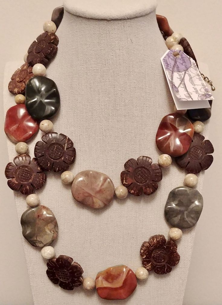 Riverstone with Mixed Semi-Precious wavy Stones and Carved Wood Flowers. Continuous loop necklace, this is a statement piece.