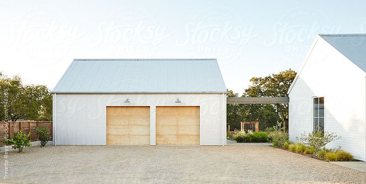 Architecture image of modern design farmhouse and garage by Trinette Reed