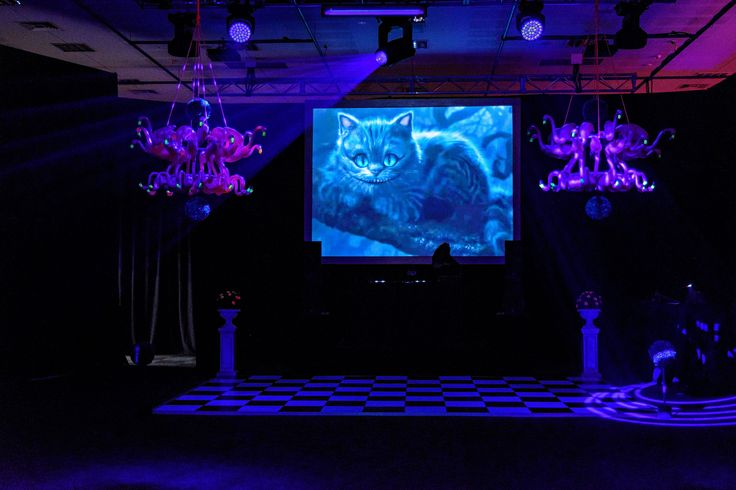 We created this uber fun Alice in Wonderland theme for our clients after gala party. Featured here are our hand made UV glow in the dark Flamingo Chandeliers. Photo by Jon Jarvela