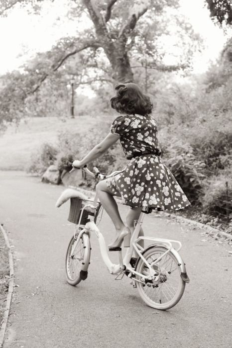 Only an amazingly fashionable and classy woman pulls of a dress and heels while out on a bike ride!