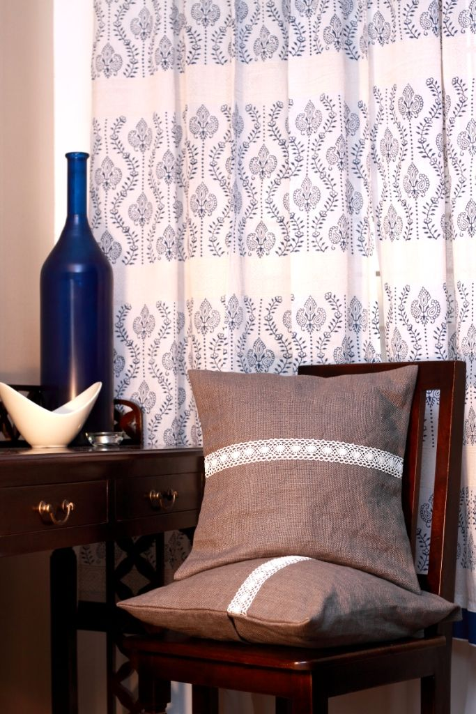 Hand block printed in indigo and offwhite and grey burlap cushion covers with lace trim